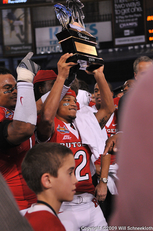 Dec 20, 2009; St. Petersburg, Fla., USA; Tim Brown holds the champion's trophy following Rutgers' 45-24 victory over Central Florida in the St. Petersburg Bowl at Tropicana Field.