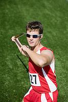 Male athlete throwing javelin