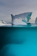 Over-under view of an iceberg, Skontorp cove, Paradise Bay, Antarctica.
