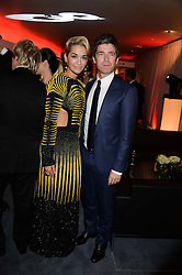 RITA ORA and NOEL GALLAGHER at the GQ Men of The Year Awards 2013 in association with Hugo Boss held at the Royal Opera House, London on 3rd September 2013.