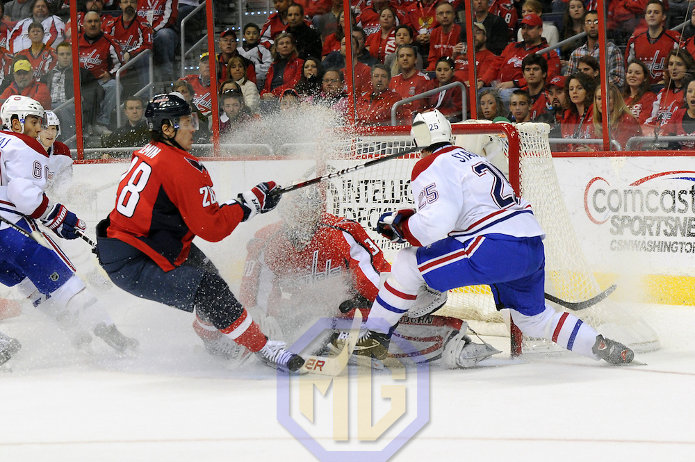 31 March 2012:  Washington Capitals goalie Michal Neuvirth (30) and left wing Alexander Semin (28) in action against Montreal Canadiens right wing Brad Staubitz (25) at the Verizon Center in Washington, D.C. where the Washington Capitals defeated the Montreal Canadiens, 3-2 in a shootout.