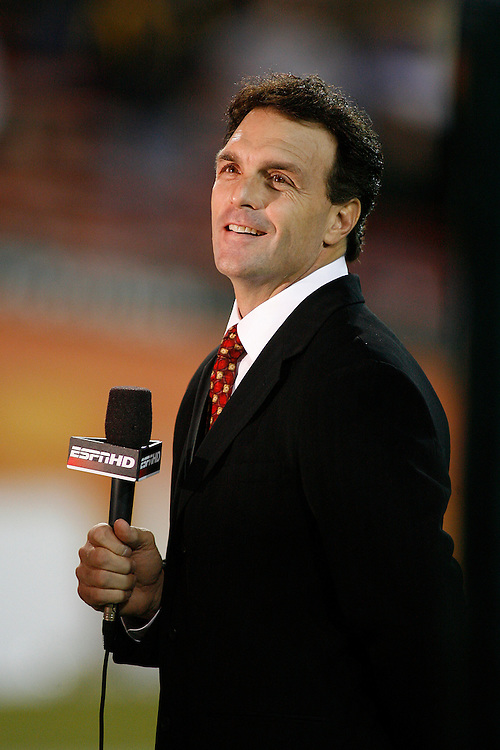 "ESPN analyst and former Boston College quarterback Doug Flutie prepares to tape a segment prior to the Miami Hurricanes 17-14 victory over Boston College at the Orange Bowl Stadium in Miami, Florida. The stadium was the site of Flutie's famous ""Hail Flutie"" play in 1984."