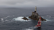 IRELAND, Fastnet Rock. 2nd July 2012. Volvo Ocean Race, Leg 9, Lorient to Galway. Camper with Emirates Team New Zealand rounds the Fastnet Rock.