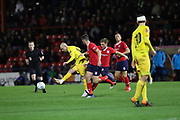Chester midfielder Adam Dawson (15) lays the ball off during the Vanarama National League match between York City and Chester FC at Bootham Crescent, York, England on 13 November 2018.