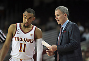 Feb 15, 2018; Los Angeles, CA, USA; Southern California Trojans coach Andy Enfield (right) talks with guard Jordan McLaughlin (11) during an NCAA basketball game against the Oregon Ducks at Galen Center. USC defeated Oregon 72-70.