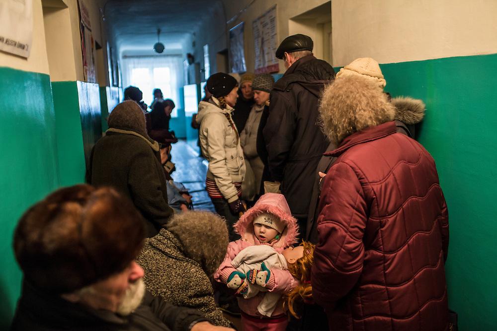ZIMOGORYE, UKRAINE - MARCH 15, 2015: Patients wait in the hallway to see a doctor at Zimogoryivskaya Ambulatory in Zimogorye, Ukraine. CREDIT: Brendan Hoffman for The New York Times