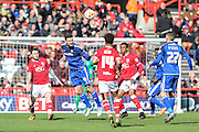 Cardiff City defender, Sean Morrison (4) heads clear during the Sky Bet Championship match between Bristol City and Cardiff City at Ashton Gate, Bristol, England on 5 March 2016. Photo by Shane Healey.