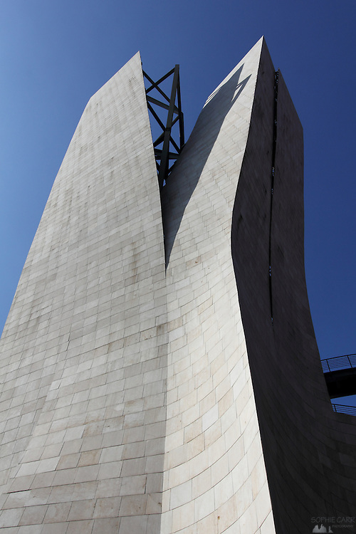 On the other side of the Puente de la Salve the Guggenheim museum ends with a split pale brick tower.