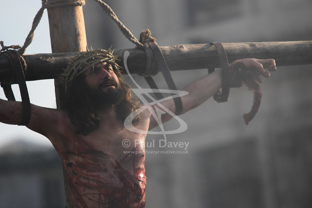 Trafalgar Square, London, March 25th 2016. Thousands of Londoners an tourists in Trafalgar Square are treated to The Passion of Jesus, a re-enactment of the events leading up to the crucifixion and resurrection of Jesus Christ. PICTURED: Jesus calls out to his Father from the cross. <br /> ©Paul Davey<br /> FOR LICENCING CONTACT: Paul Davey +44 (0) 7966 016 296 paul@pauldaveycreative.co.uk