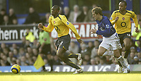 Photo: Aidan Ellis.<br /> Everton v Arsenal. The Barclays Premiership. 21/01/2006.<br /> Everton's Phil Neville chases Arsenal's Abou Diaby