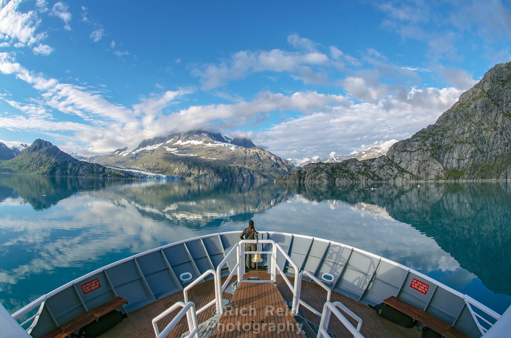 Bow of the National Geographic Sea Lion and the Fairweather Range in Glacier Bay National Park and Preserve in Alaska.