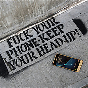 Cellphone graffiti stencil &quot;FUCK YOUR PHONE-KEEP YOUR HEAD UP!&quot;<br />
