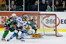 Rob Hisey (EHC Liwest Linz, #26) vs Ales Music (HDD Tilia Olimpija, #16) and Matija Pintaric (HDD Tilia Olimpija, #69) during ice-hockey match between HDD Tilia Olimpija and EHC Liwest Black Wings Linz at fourth match in Semifinal  of EBEL league, on March 13, 2012 at Hala Tivoli, Ljubljana, Slovenia. (Photo By Matic Klansek Velej / Sportida)