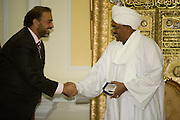 British Labour peer, Lord Ahmed of Rotherham is thanked by Sudanese President, Omar Hassan Ahmad al-Bashir after receiving a gift of a pen and mints for the head of state's two wives, in a reception room of his palace in central Khartoum. Al Bashir is head of the National Congress Party and has been in power since October 1993. Nazir, Baron Ahmed (born 1958) is a member of the House of Lords, having become the United Kingdom's first Muslim life peer in 1998 and is in this war-torn province of Sudan to attend the first-ever international Conference on Womens' Challenge in Darfur, hosted by the govenor in his own compound.