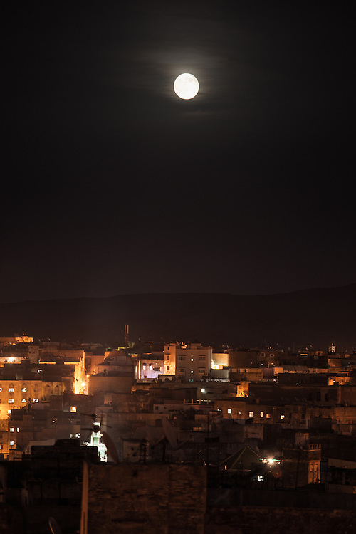 Moonrise over the medina of Fez, Morocco.