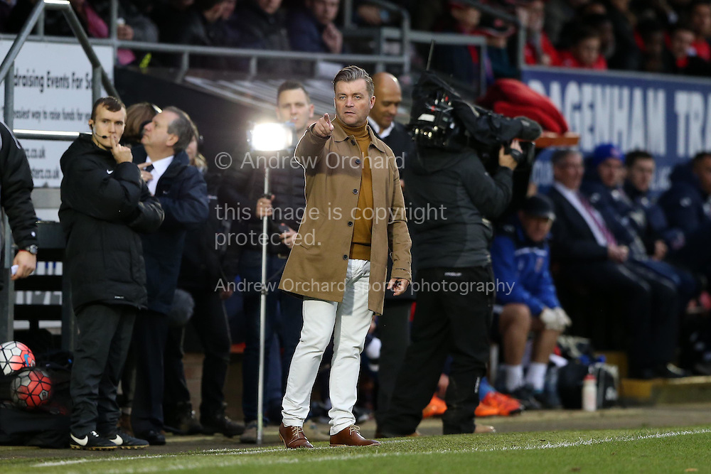 Steve King, the Whitehawk manager (c) looks on from the touchline. The Emirates FA Cup, 2nd round match, Dagenham &amp; Redbridge v Whitehawk FC at the The London Borough of Barking &amp; Dagenham Stadium in London on Sunday 6th December 2015.<br /> pic by John Patrick Fletcher, Andrew Orchard sports photography.
