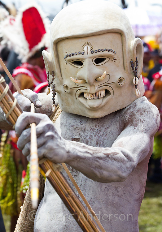 Portrait of an Asaro mudman. He is dressed in traditional tribal dress for the Goroka Show, an annual Singsing Festival in the highlands of Papua New Guinea