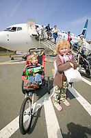 Young visitors arriving at the Comox Airport arrive prepared to visit and explore the Comox Valley (YQQ) Comox, Vancouver Island, British Columbia, Canada.
