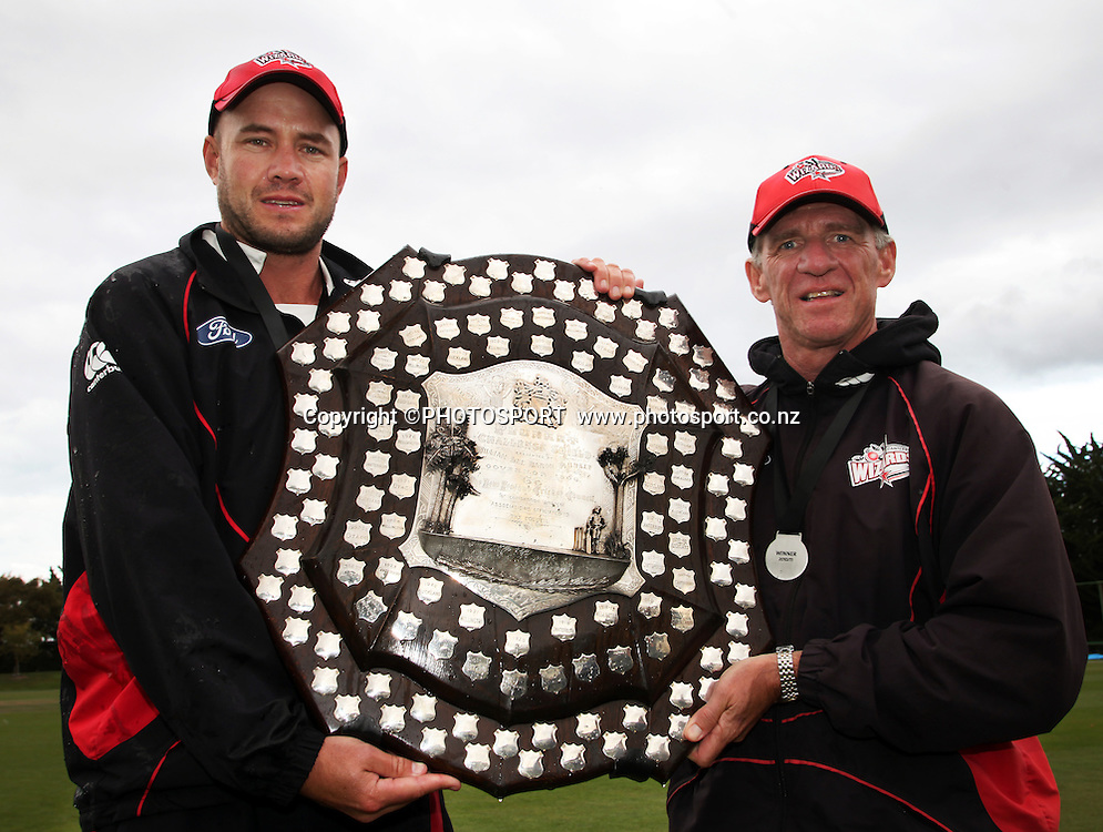 Canterbury Wizards captain Peter Fulton and coach Bob Carter hold the Plunket Shield after the team won on the final day. Canterbury Wizards v Northern Knights, Plunket Shield Game held at Mainpower Oval, Rangiora, Thursday 07 April 2011. Photo : Joseph Johnson / photosport.co.nz