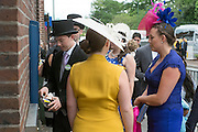 © Licensed to London News Pictures. 18/06/2014. Ascot, UK. A man gets money from an ATM.  Day two at Royal Ascot 18th June 2014. Royal Ascot has established itself as a national institution and the centrepiece of the British social calendar as well as being a stage for the best racehorses in the world. Photo credit : Stephen Simpson/LNP