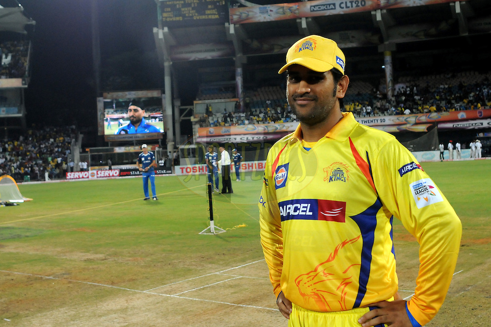 Mahendra Singh Dhoni captain of Chennai Super Kings during the toss before the start of the match 3 of the NOKIA Champions League T20 ( CLT20 )between the Chennai Superkings and the Mumbai Indians held at the M. A. Chidambaram Stadium in Chennai , Tamil Nadu, India on the 24th September 2011..Photo by Pal Pillai/BCCI/SPORTZPICS