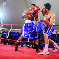 080115       Cable Hoover<br /> <br /> Jose Osorio, right, breaks through a block from Guillermo Alvarez during Fire and Ice Fury boxing in Grants Saturday.