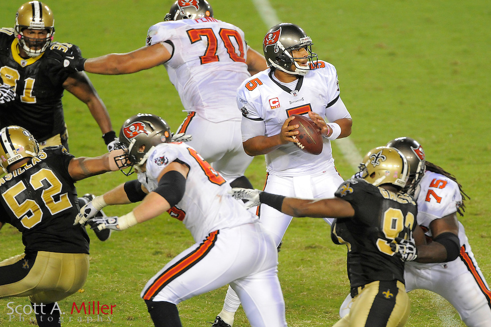 Tampa Bay Buccaneers quarterback Josh Freeman (5) looks to pass during the Bucs 26-20 win over the New Orleans Saints at Raymond James Stadium on Oct. 16, 2011 in Tampa, Fla...©2011 Scott A. Miller
