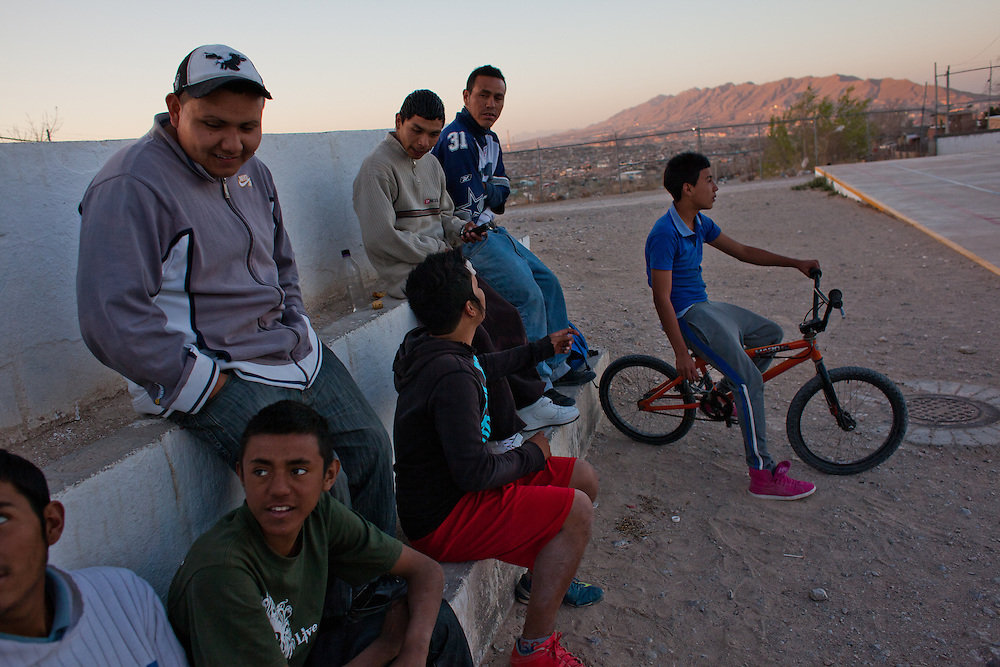 """Youth, primarily of the gang """"Los Noveno"""" hang out in a soccer field in the Diaz Ordaz colonia, one of the poorest communities of Ciudad Juarez. Within the last two months one of their members was murdered."""