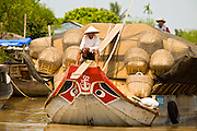 12 MARCH 2006 - CAI BE, TIEN GIANG, VIETNAM: A barge hauls rice husks up a canal near Cai Be in the Mekong River delta. The Vietnamese burn the husks for fuel in small factories and then use the husk ash as fertilizer in their rice paddies. The Mekong is the lifeblood of southern Vietnam. It is the country's rice bowl and has enabled Vietnam to become the second leading rice exporting country in the world (after Thailand). The Mekong delta also carries commercial and passenger traffic throughout the region.  Photo by Jack Kurtz
