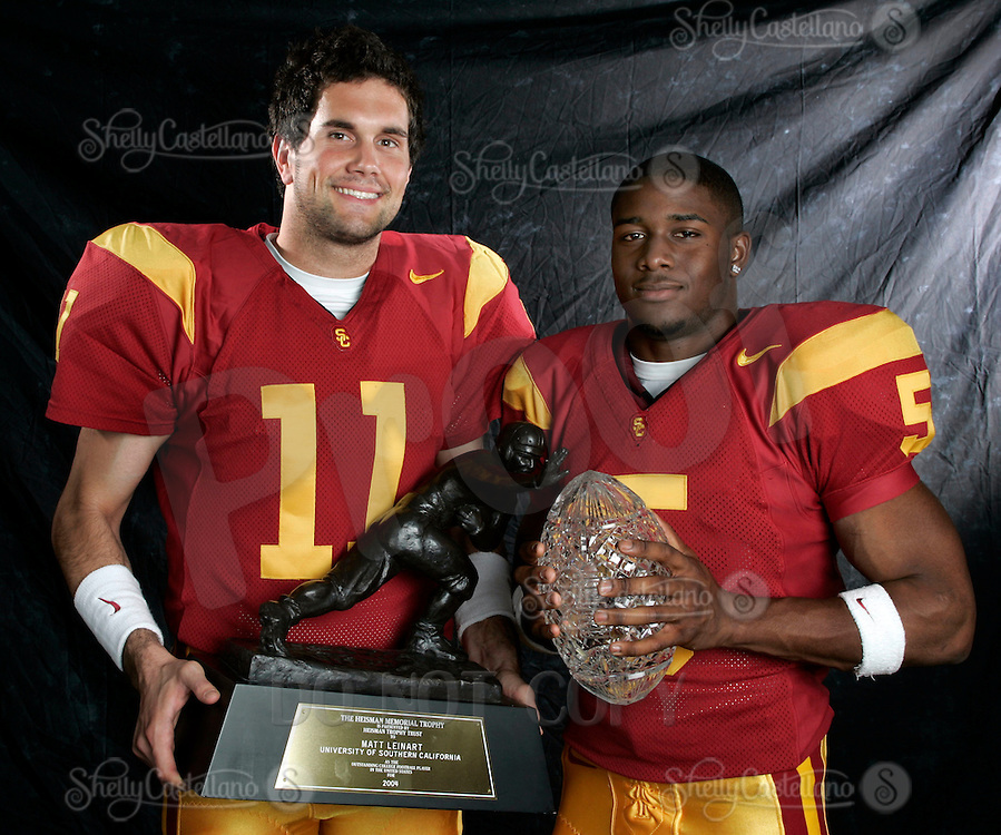 7 April 2005: USC Trojan Quarterback Matt Leinart with the 2004 Heisman Trophy and Reggie Bush with the National Championship Crystal Football Trophy. Portrait session on campus with players.
