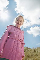 Girl (5-6) smiling in countryside portrait