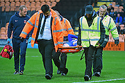 Hartlepool United midfielder Nathan Thomas (7) is carried off injured during the EFL Sky Bet League 2 match between Barnet and Hartlepool United at Underhill Stadium, London, England on 29 October 2016. Photo by Jon Bromley.