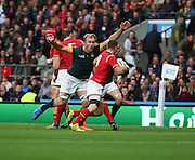 South Africa's Schalk Burger charging down Wales Gareth Davies during the Rugby World Cup Quarter Final match between South Africa and Wales at Twickenham, Richmond, United Kingdom on 17 October 2015. Photo by Matthew Redman.
