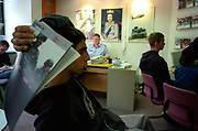 Bored teenage boys at an Army recruitment office London UK c.2000