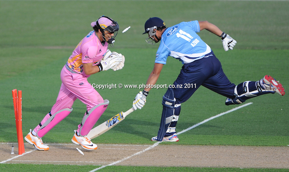 Northern wicketkeeper Peter McGlashan whips the bails off to dismiss Azhar Mahmood during the HRV Twenty20 Cricket match between the Auckland Aces and Northern Knights at Colin Maiden Oval in Auckland on Monday 26 December 2011. Photo: Andrew Cornaga/Photosport.co.nz