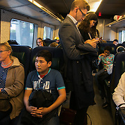 Young refugees on the train to Sweden from Denmark.  An unprecedented number of refugees arrived from Germany in early September, most being Syrian war refugees, some from Afghanistan. Most wanted to travel on to Sweden and a number of Danish citizens created a spontanious network to assist the refugees with travel, food, clothes and psycological support.