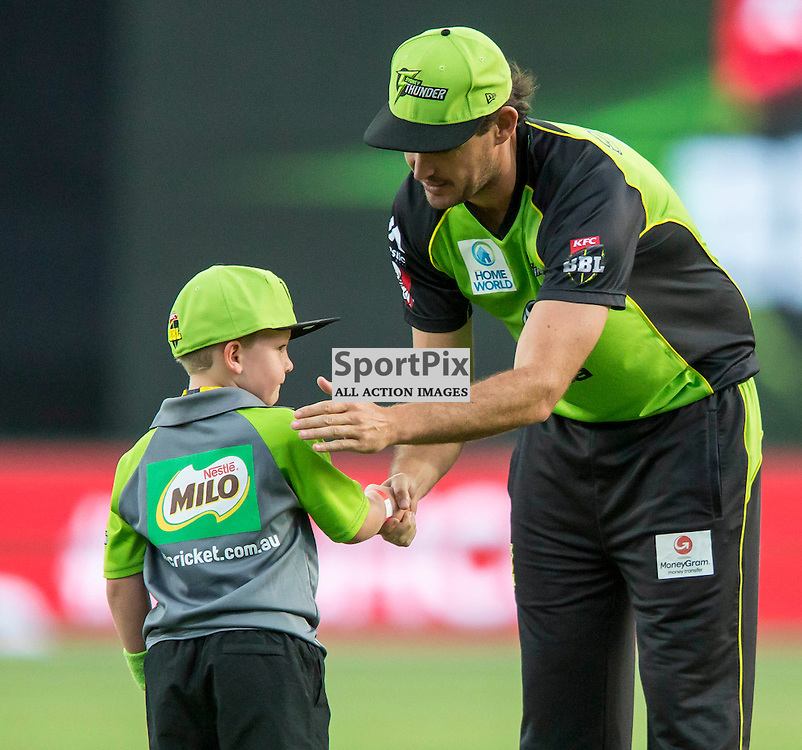 KFC Big Bash League T20 2015-16 , Sydney Thunder v Perth Scorchers, Spotless Stadium; 7 January 2016<br /> Sydney Thunder Clint McKay Shakes hands with a young supporter before the game.