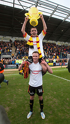 Partick Thistle's Christie Elliot (16) and Partick Thistle's Steven Lawless..Partick Thistle cele winning the Scottish Football League Division One..Falkirk 0 v 2 Partick Thistle, 20/4/2013..© Michael Schofield.