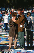 Family members comfort each other as they view the AIDS Memorial Quilt which was spread out along the National Mall October 12, 1996 in Washington, DC.