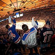 April 12, 2012: Fans cheer a goal by the New York Rangers during the Eastern Conference Quarter Finals against the Ottawa Senators at  Madison Square Garden in Manhattan, New York . The New York Rangers defeat the Ottawa Senators 4-2.  (Credit Image: © Kostas Lymperopoulos/Cal Sport Media)