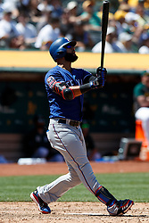 OAKLAND, CA - JULY 28:  Nomar Mazara #30 of the Texas Rangers hits a home run against the Oakland Athletics during the sixth inning at the RingCentral Coliseum on July 28, 2019 in Oakland, California. The Oakland Athletics defeated the Texas Rangers 6-5. (Photo by Jason O. Watson/Getty Images) *** Local Caption *** Nomar Mazara