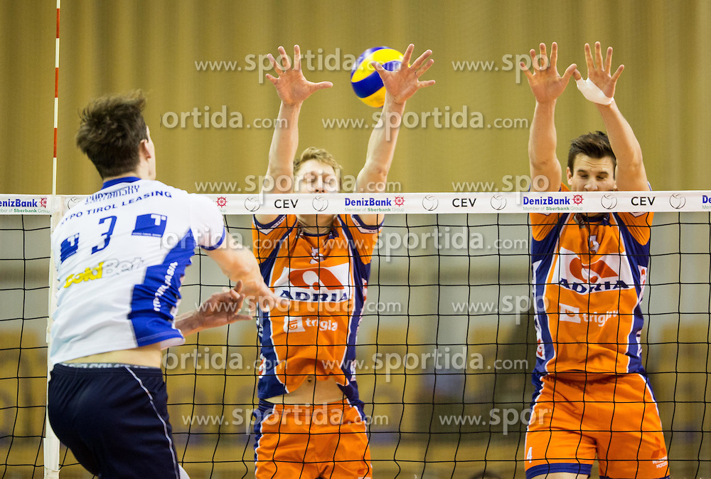 Stefan Provenzano de Deus of Hypo Tirol vs Samuel Walker and Jan Kozamernik of ACH during volleyball match between Hypo Tirol Innsbruck and OK ACH Volley in Final of MEVZA Cup Men -Final Four, on March 12, 2016 in Hala Tivoli, Ljubljana, Slovenia. Photo by Vid Ponikvar / Sportida