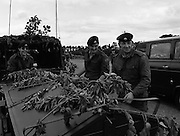 """Army Exercises In Co Sligo.   (L37).<br /> 1977.<br /> 05.09.1977.<br /> 09.05.1977.<br /> 5th September 1977.<br /> The Army Reserve Brigade, which is made up of regular units from the Southern Command, are conducting a series of conventional military exercises in counties Mayo and Sligo from the 5th to the 9th September. Approximately 1,500 men and 250 vehicles are involved. The exercise was codenamed """"Humbert"""" after an ill fated expedition by French troops into Ireland on 23rd August 1798. 1,100 French troops with Irish support took on the incumbent English forces. After some initial success they were defeated at Ballinamuk on 8th Sept 1798 by the army of Cornwallis.<br /> <br /> Photograph shows some army personnal adding camouflage to their vehicle as the exercise begins.<br /> (L-R) Signalman Martin Cahill, Signalman John O'Brien and Signalman J E Pentony."""