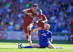 CARDIFF, WALES - Saturday, April 20, 2019: Liverpool's Roberto Firmino (L) and Cardiff City's goalkeeper Alex Smithies during the FA Premier League match between Cardiff City FC and Liverpool FC at the Cardiff City Stadium. (Pic by David Rawcliffe/Propaganda)