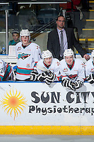 KELOWNA, CANADA - JANUARY 22: Kris Mallette, assistant coach, Lucas Johansen #7, Gordie Ballhorn #4 and Tate Coughlin #18 of Kelowna Rockets stand on the bench against the Tri City Americans on January 22, 2016 at Prospera Place in Kelowna, British Columbia, Canada.  (Photo by Marissa Baecker/Shoot the Breeze)  *** Local Caption *** Kris Mallette; Lucas Johansen; Gordie Ballhorn; Tate Coughlin;