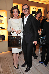 BRUNO FRISONI and FRANCINE PETER at a party to celebrate the arrival of the 'A Princess to be a Queen' collection at the Roger Vivier boutique on Sloane Street, London on 20th October 2009.