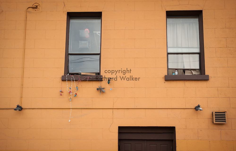 2013 March 21  - Georgetown, Seattle, WA. Objects dangle from a window sill behind a building. Photo by Richard Walker