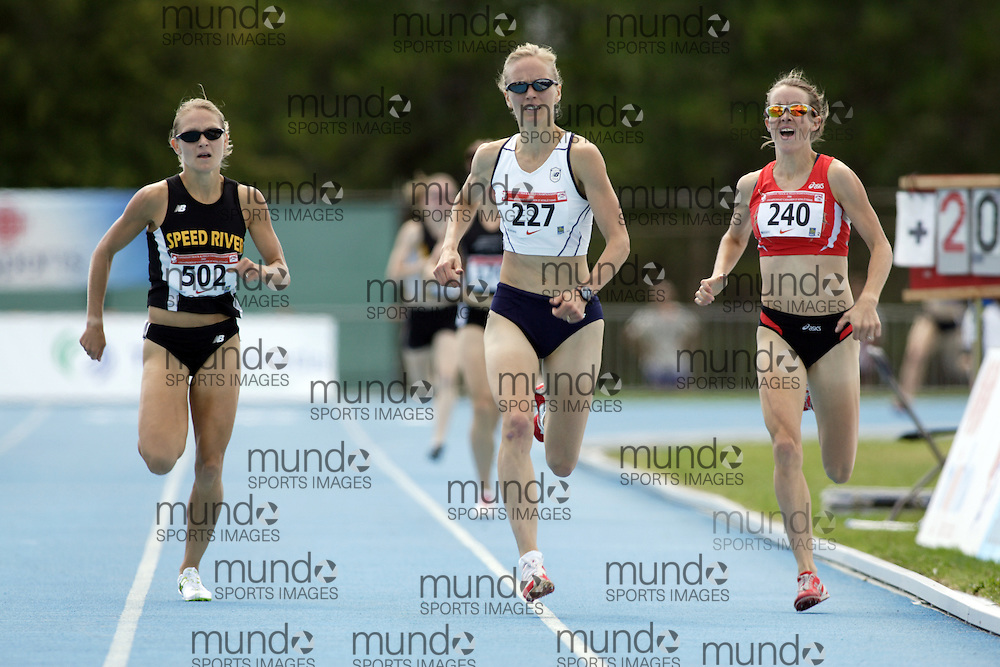 The women's 1500m final at the 2006 Canadian Senior Track and Field Championships held in Ottawa 4-6 August 2006. #227 Carmen Douma-Hussar won #502 Hilary Stellingwerf was second and #240 Malindi Elmore was third.