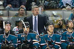 March 23, 2011; San Jose, CA, USA;  San Jose Sharks head coach Todd McLellan stands on behind his team on the bench against the Calgary Flames during the first period at HP Pavilion. Mandatory Credit: Jason O. Watson / US PRESSWIRE