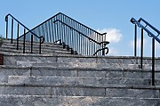 outdoor cement steps and iron bars